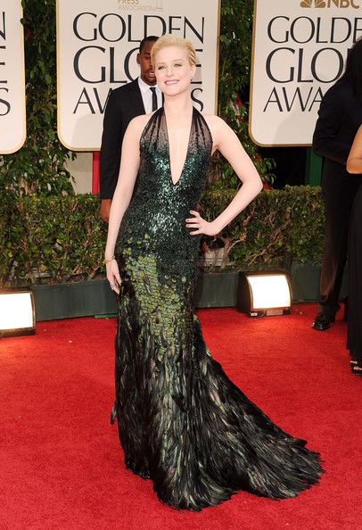 Evan Rachel Wood, who was nominated for Best Performance by an Actress in a Supporting Role in a Motion Picture Made for Television for Mildred Pierce, wore a custom designed Gucci Première halter neck gown and black suede evening sandals. The midnight green dress is embroidered with overlapping fish scale paillettes and ostrich plumes, graduating into a full skirt of iridescent feathers.