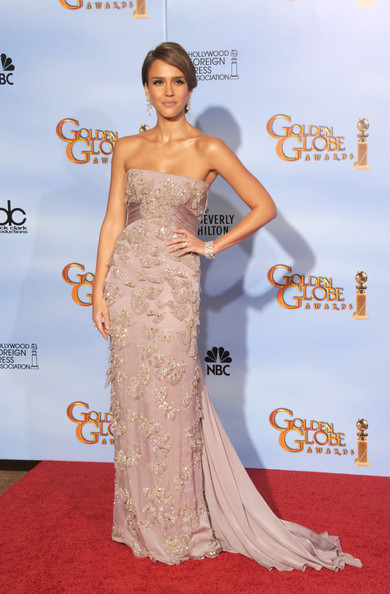Jessica Alba presented wearing a Gucci pale lilac Première silk charmeuse embroidered evening gown. The dress features crystal encrusted organza petals, light crystal drops and a high-waisted sash that drapes into a pleated train.