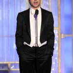 Presenter Robert Downey Jr. wore a Gucci black custom tuxedo jacket with tails, tuxedo trousers, white dress shirt, white pique cotton vest, white silk bowtie and black lace ups.